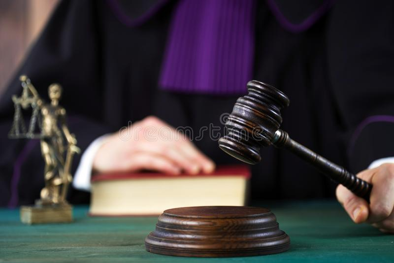 Judge with a wooden judge`s gavel. Supreme Court. Judges gown royalty free stock images