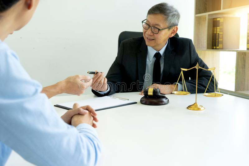 Judge work at the table talk with wife husband royalty free stock photography