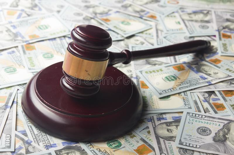 Judges Or Auctioneer Gavel On The Dollar Cash Background, Concept For Corruption, Bankruptcy, Auction Bidding, Fines. Judges Or Auctioneer Gavel On The Dollar stock photo