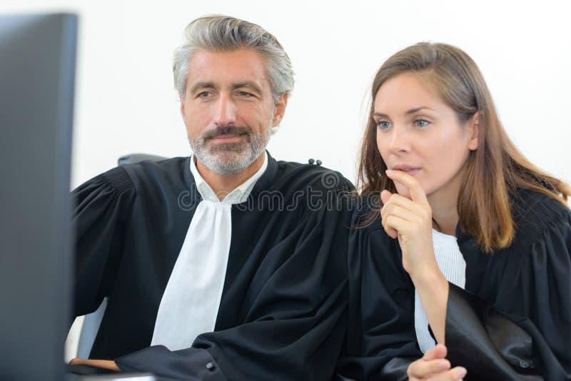 Judges at a computer stock photos