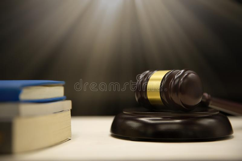 Judges gavel and book on wooden table. royalty free stock photo
