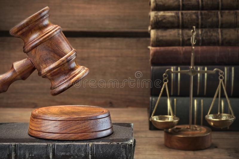 Judges Gavel, Legal Code And Scales Of Justice Closeup. Closeup Of Judges Gavel, Legal Code, Scales Of Justice On The Rough Wooden Background. Law Concept royalty free stock photos