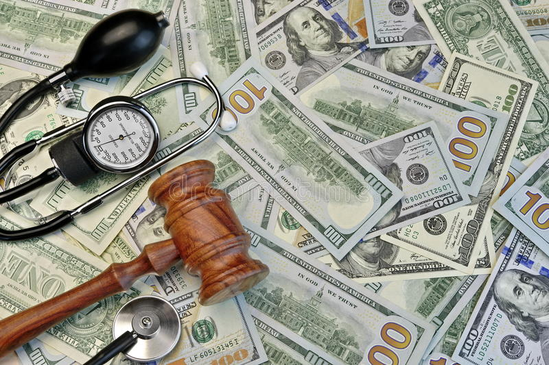 Judges Gavel And Medical Tools On Dollar Cash Background stock image