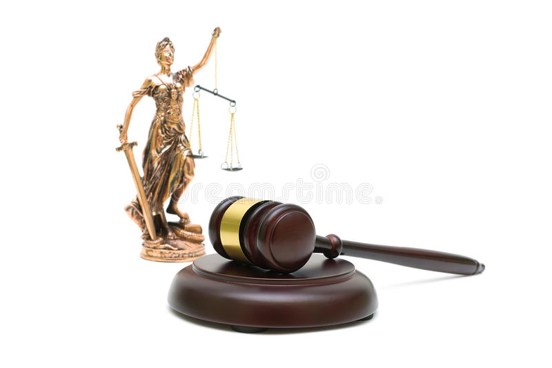 Judges gavel and the statue of justice on white background. Judges gavel and the justice statue in the background isolated on white background. horizontal photo royalty free stock images