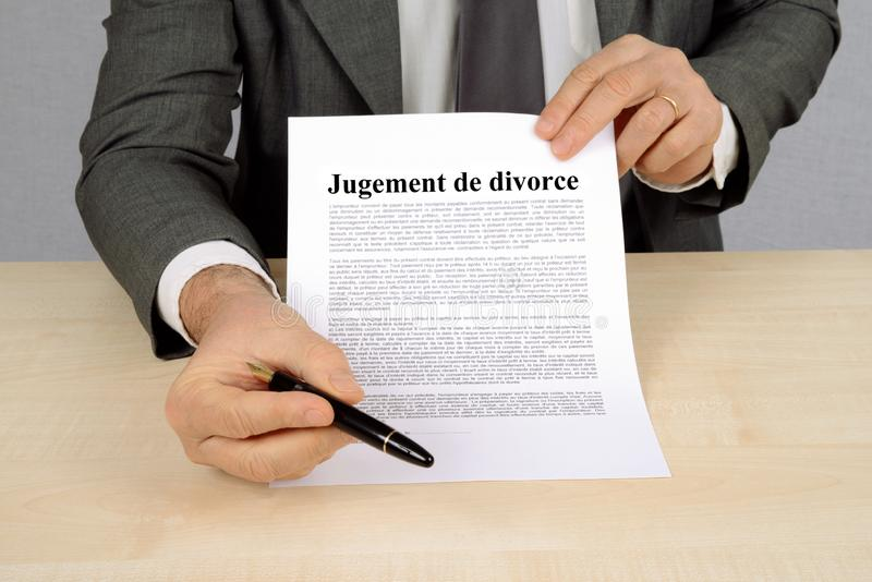 Judgment of divorce written in French. Unrecognizable man presenting a divorce judgment written in French royalty free illustration