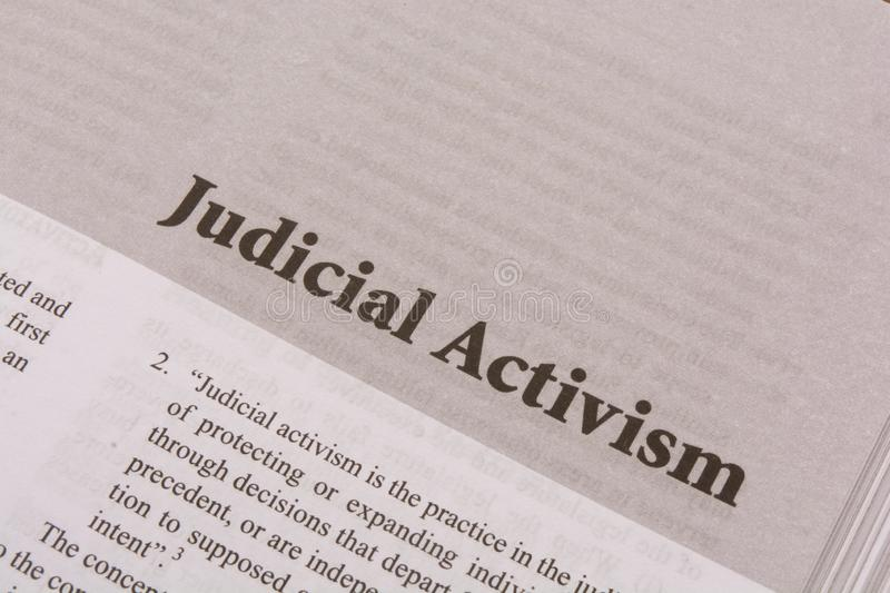 Judicial Activism print on a paper as a headline.  royalty free stock photography