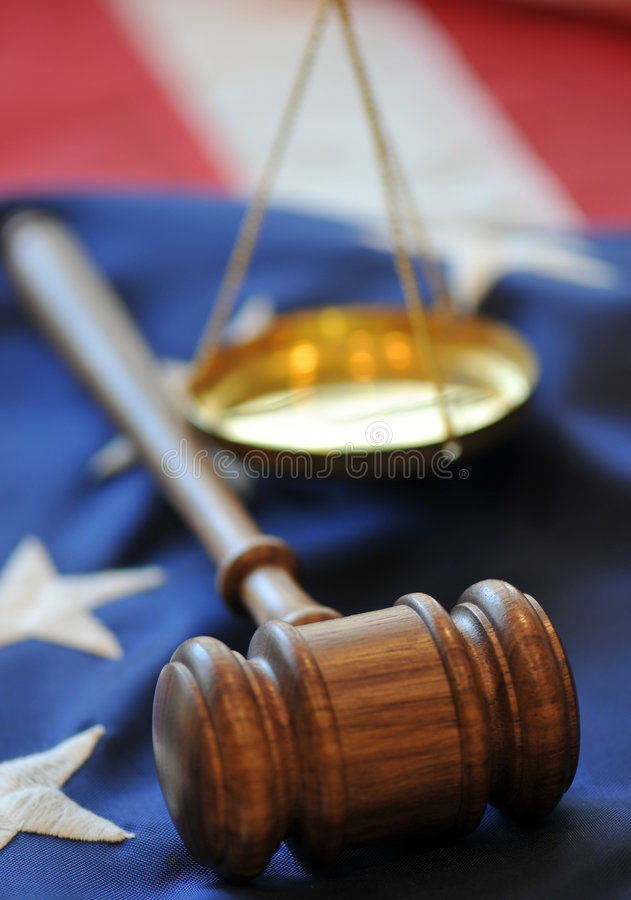 Judicial Branch. Gavel, scale (our of focus) and flag background in a portrayal of American Judicial system royalty free stock photos