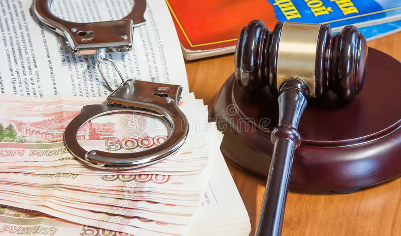 Judicial hammer, codes of laws, handcuffs and money. Of the Russian Federation stock photos
