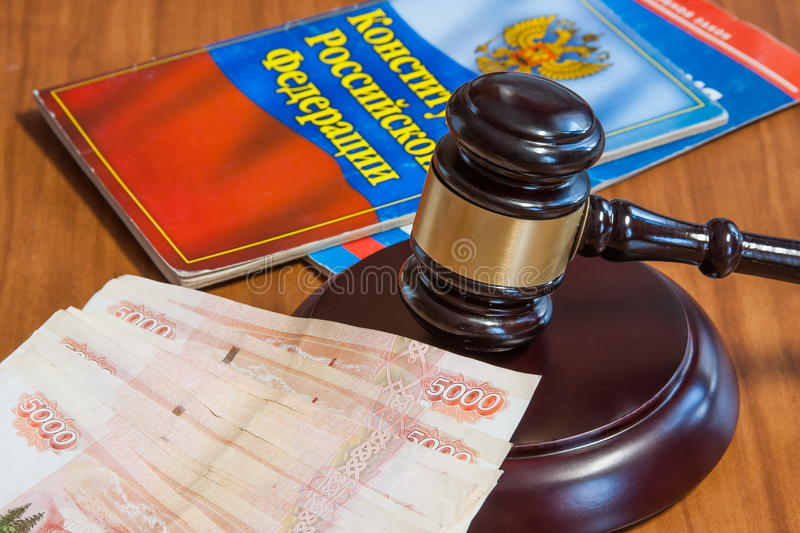 Judicial hammer, codes of laws and money. Of the Russian Federation stock photos