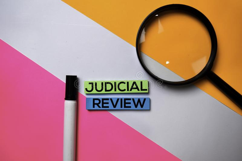 Judicial Review text on sticky notes with color office desk concept royalty free stock photo