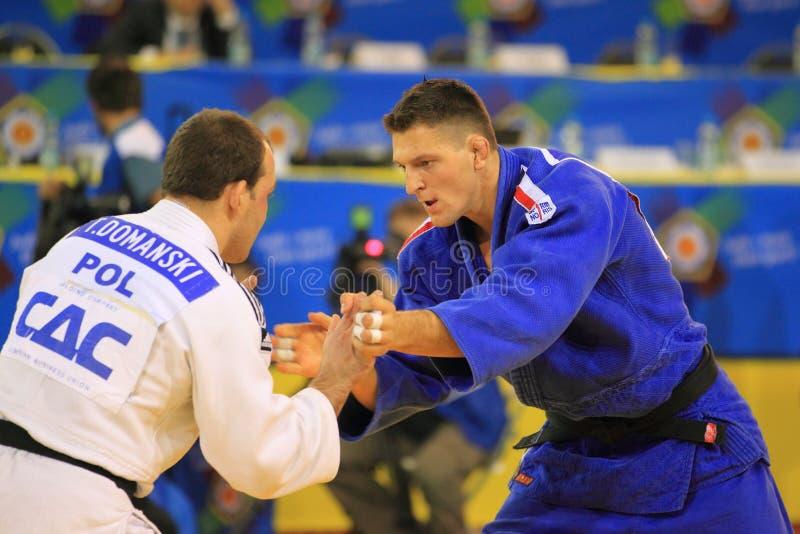 Judo - Lukas Krpalek och Tomasz Domanski arkivbilder