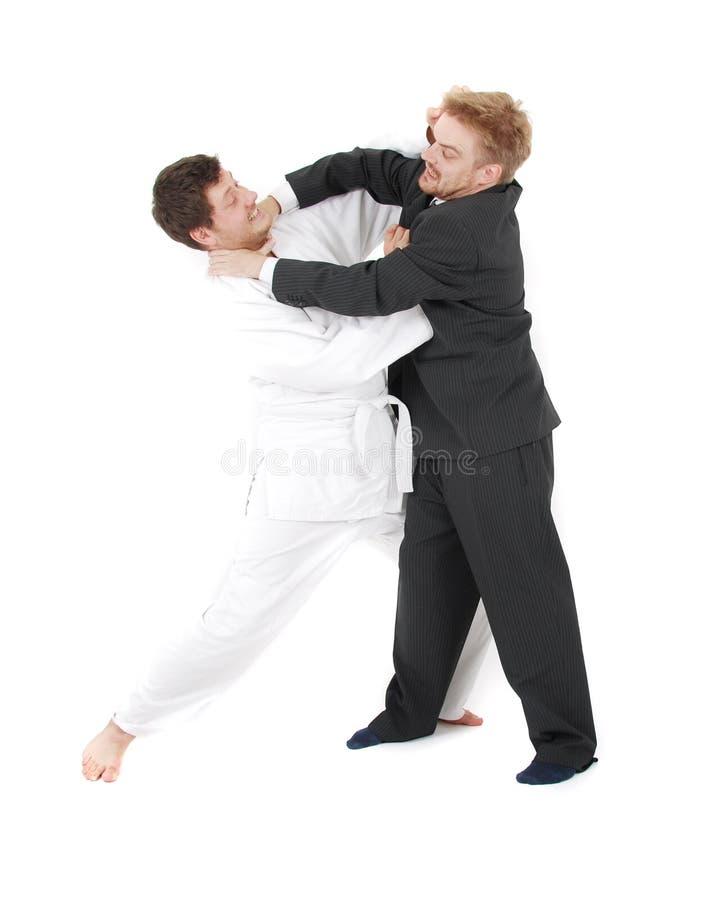 Judoist contra hombre de negocios fotos de archivo