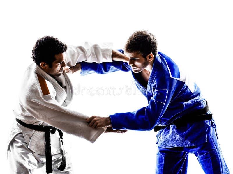 Judokas fighters fighting men silhouette royalty free stock photo