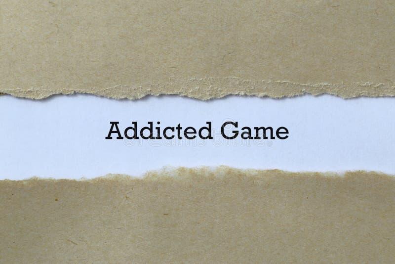 Juego adicto en el papel imagenes de archivo