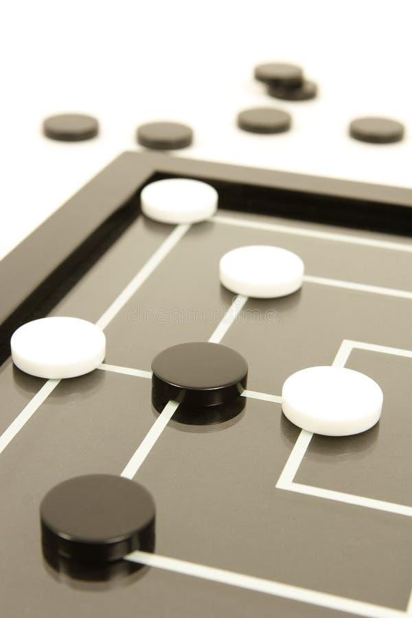 Juego de mesa blanco y negro fotografía de archivo