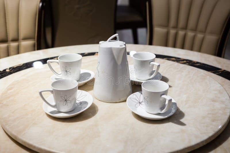Juego de té de la porcelana fotos de archivo