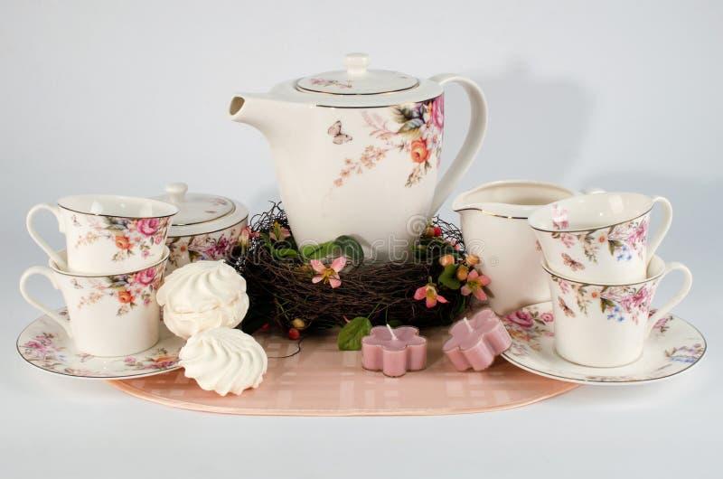 Juego de té y melcochas imagen de archivo