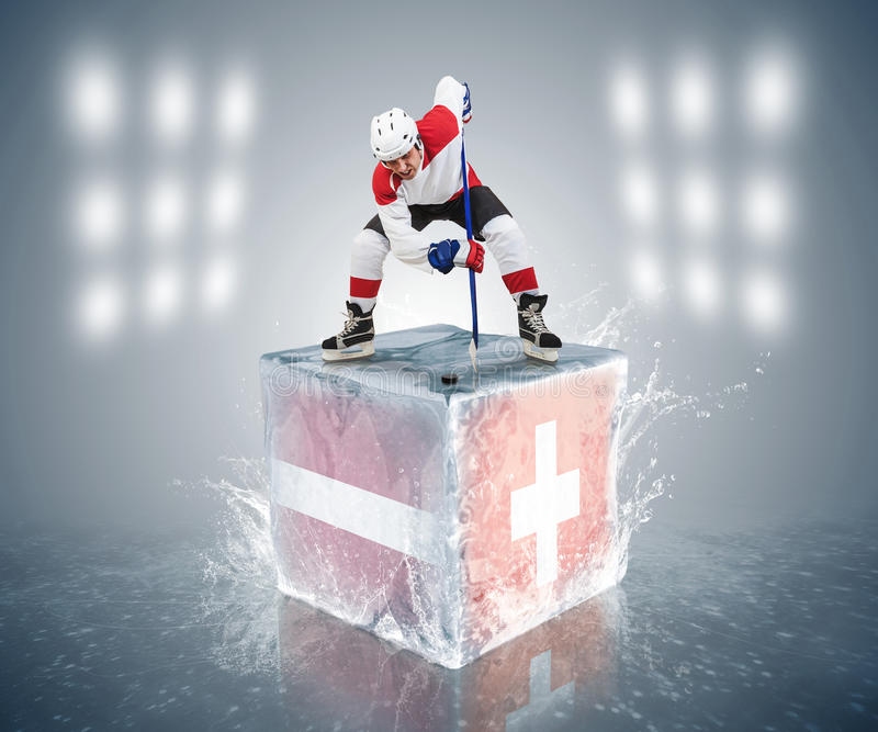 Juego de torneo de Letonia - de Suiza. Aliste para el jugador de la cara-apagado en el cubo de hielo. imagenes de archivo