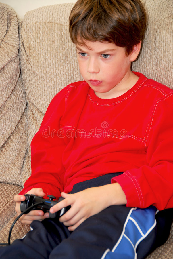 Juego video del muchacho foto de archivo