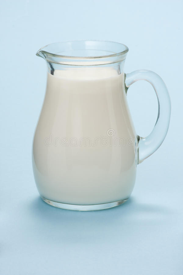 Download Jug With Fresh Milk On A Blue Stock Photo - Image: 28906064