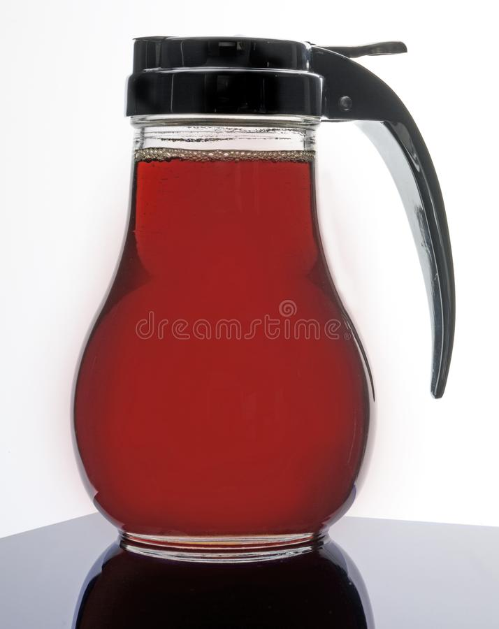 JUG OF MAPLE SYRUP royalty free stock image