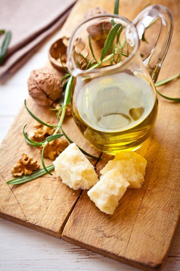 Download Jug Of Olive Oil, Grana Padano Cheese And Walnuts Stock Photo - Image of olive, italian: 22403702