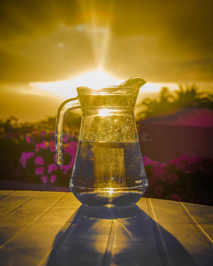 A jug of potable water. And the sunset stock photos