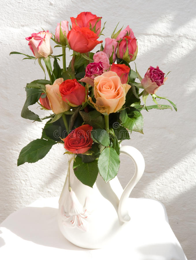Jug of roses. royalty free stock photo