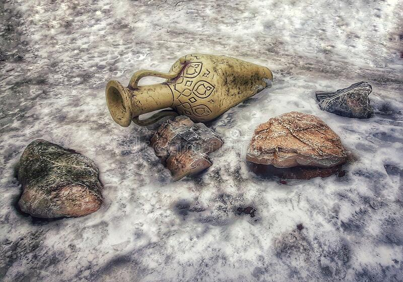 Jug with three stones on a beautiful winter background stock photo