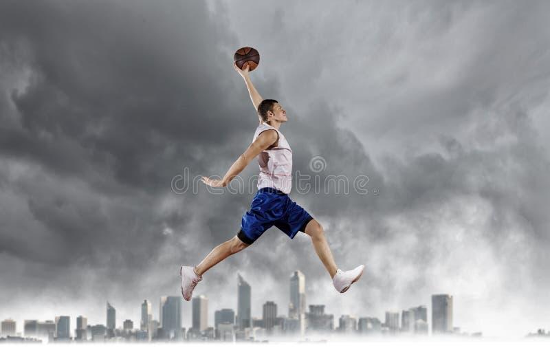 Jugador de básquet imagenes de archivo