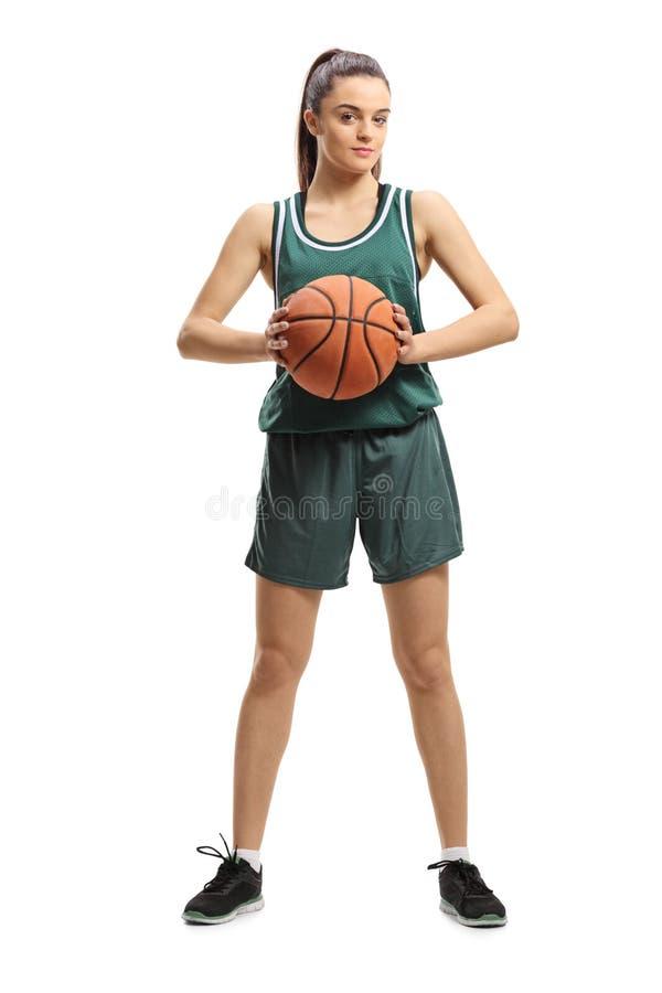 Jugador de básquet de sexo femenino que celebra una cesta y una presentación imagen de archivo libre de regalías