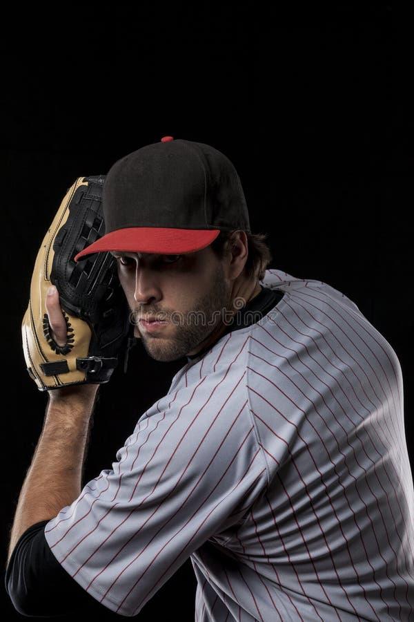 Jugador de béisbol en un uniforme rojo. fotos de archivo