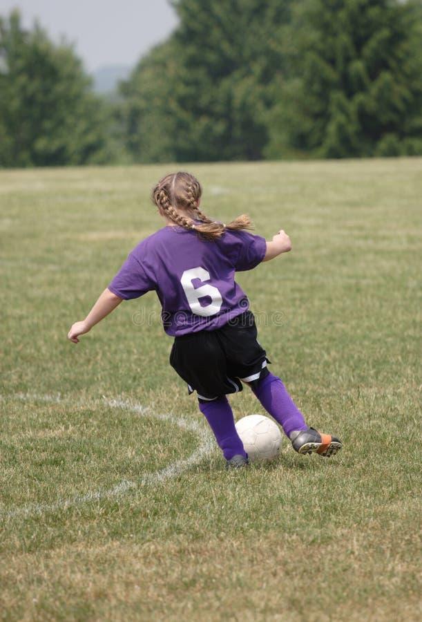 Jugador de fútbol adolescente en la acción 5 fotografía de archivo libre de regalías