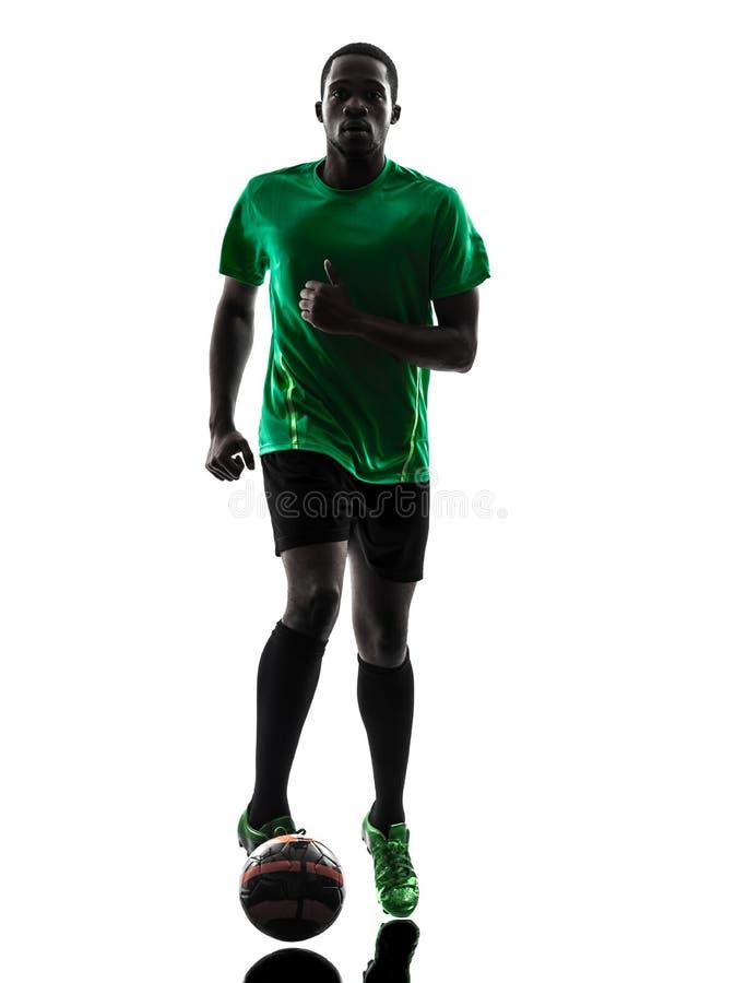 Jugador de fútbol africano del hombre   silueta corriente fotos de archivo