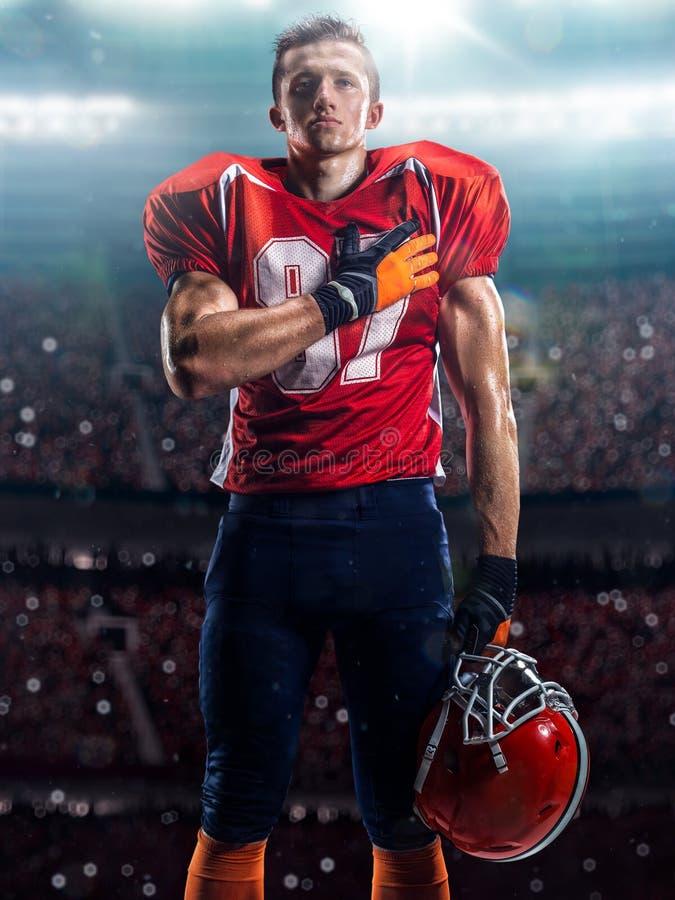 Jugador de fútbol americano en la acción fotos de archivo libres de regalías