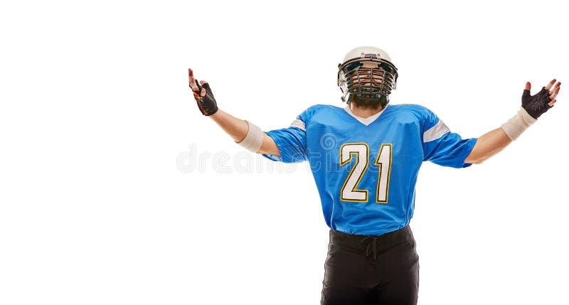 Jugador de fútbol americano en las actitudes uniformes para la cámara Un atleta hermoso en uniforme en un fondo blanco con a imagenes de archivo