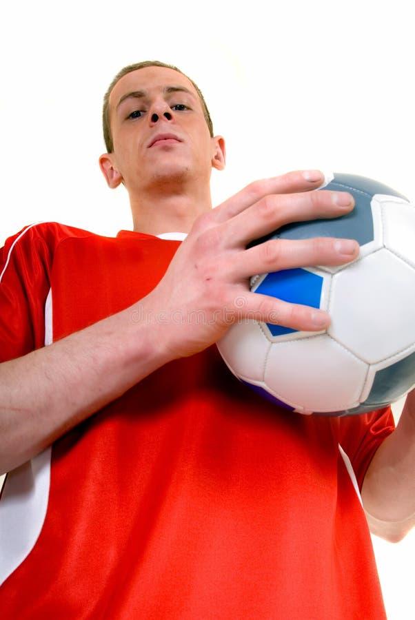 Jugador de fútbol de sexo masculino joven imagen de archivo libre de regalías
