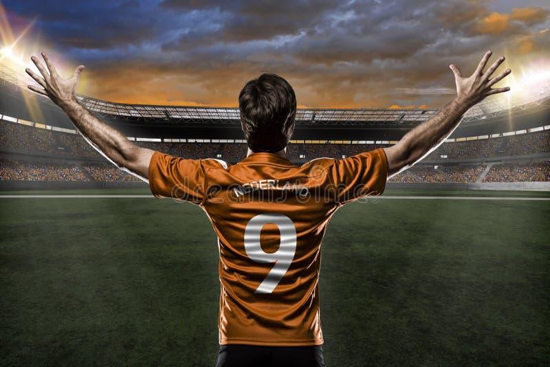 Jugador de fútbol del remiendo fotografía de archivo libre de regalías