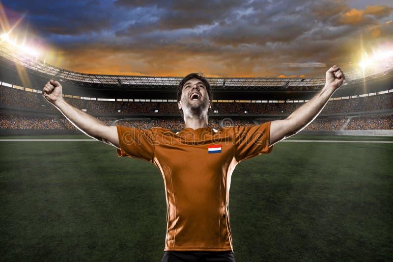 Jugador de fútbol del remiendo fotos de archivo