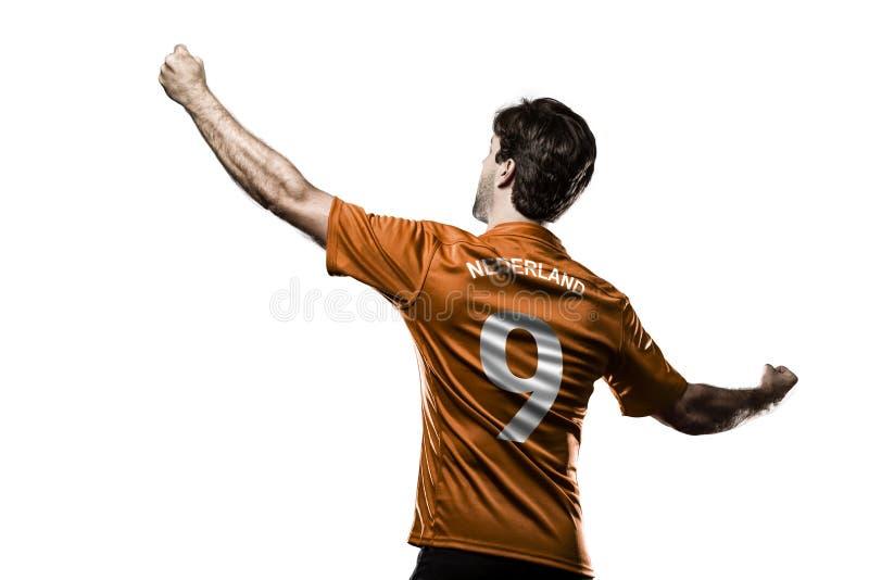 Jugador de fútbol del remiendo imagen de archivo