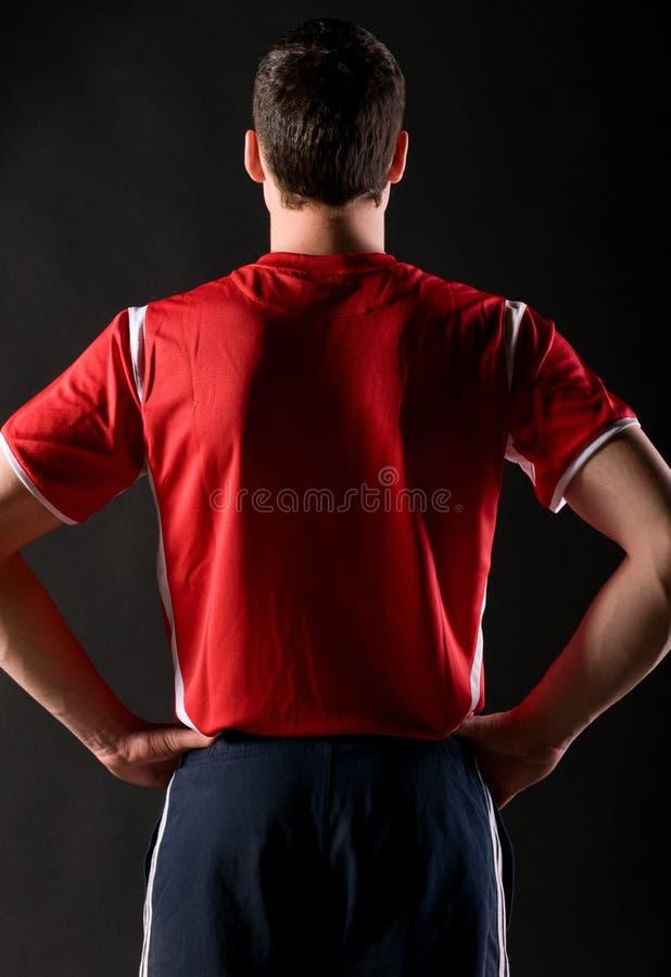 Jugador de fútbol en obscuridad foto de archivo libre de regalías