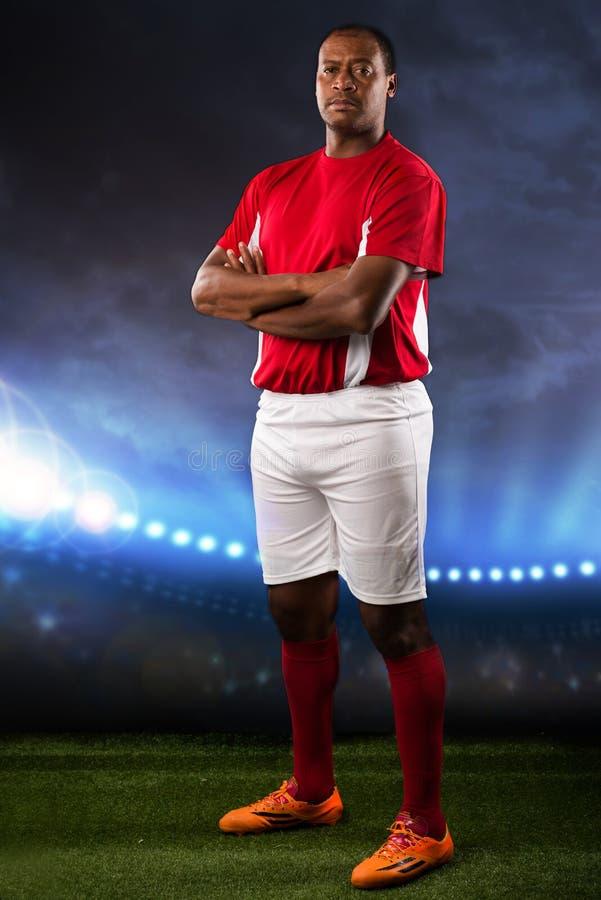 Jugador de fútbol en una echada fotografía de archivo libre de regalías