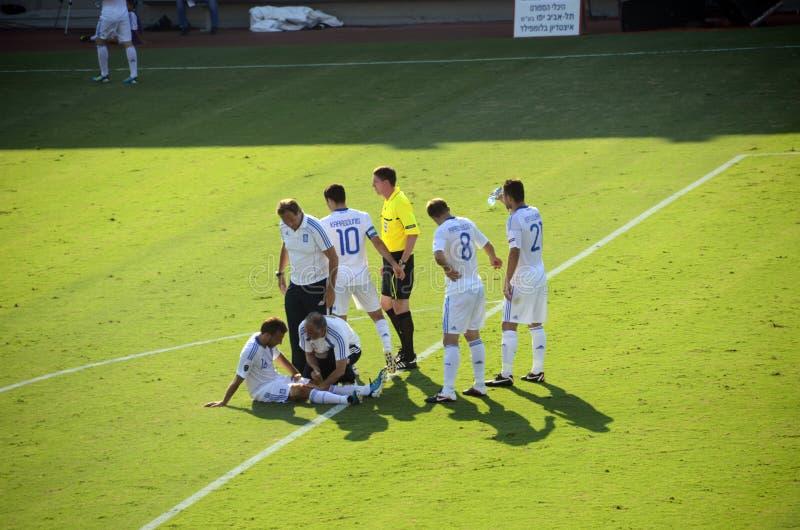 Jugador de fútbol griego dañado - Pantelis Kafes fotografía de archivo