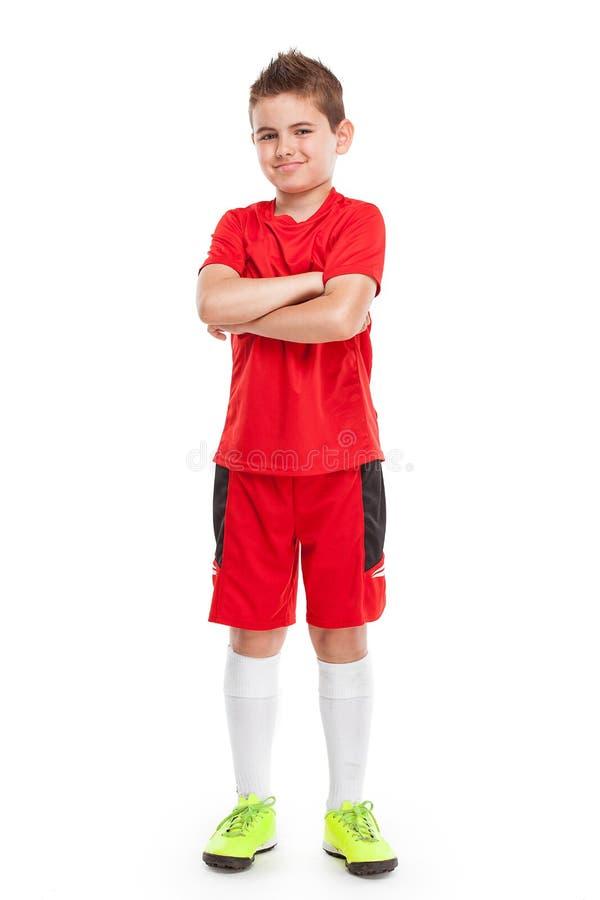 Jugador de fútbol joven derecho en ropa de deportes imagenes de archivo