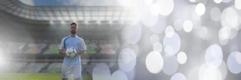Jugador de fútbol que celebra fútbol en estadio fotos de archivo