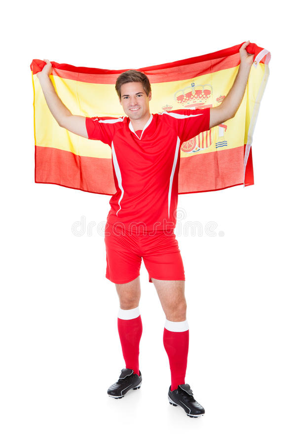 Jugador de fútbol que celebra la bandera española fotografía de archivo