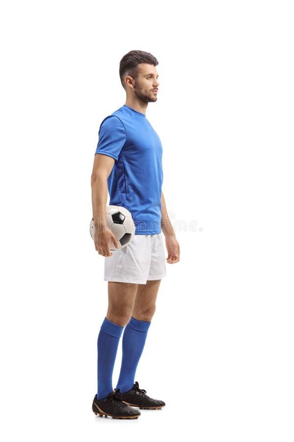 Jugador de fútbol que espera en línea fotos de archivo