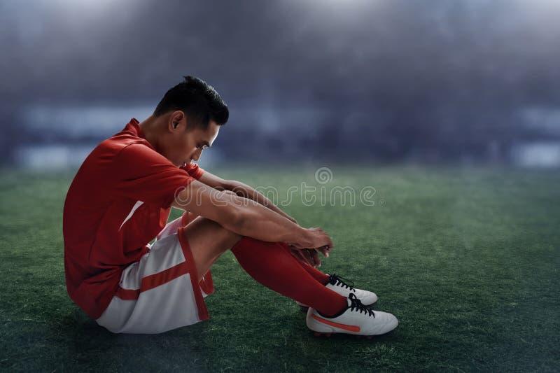 Jugador de fútbol que pierde el partido fotos de archivo libres de regalías