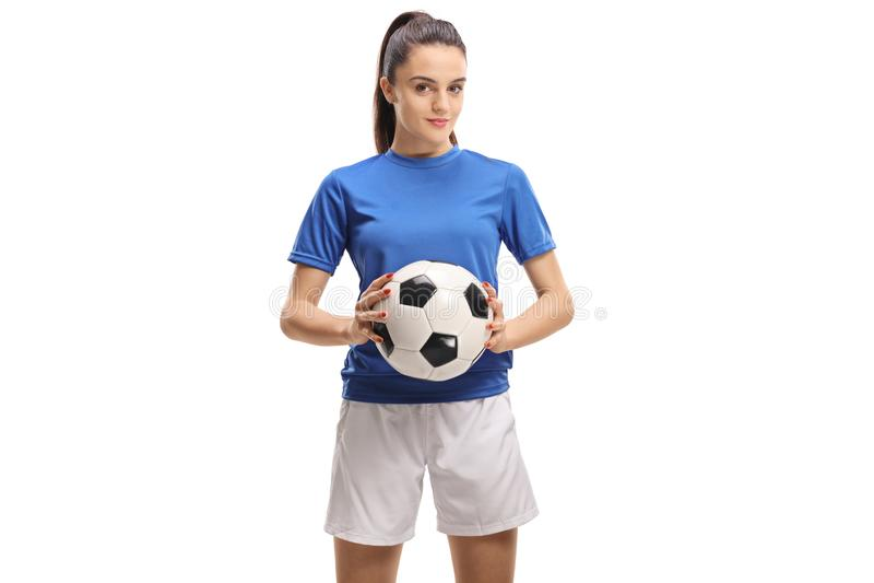 Jugador de fútbol de sexo femenino que celebra un fútbol imagen de archivo