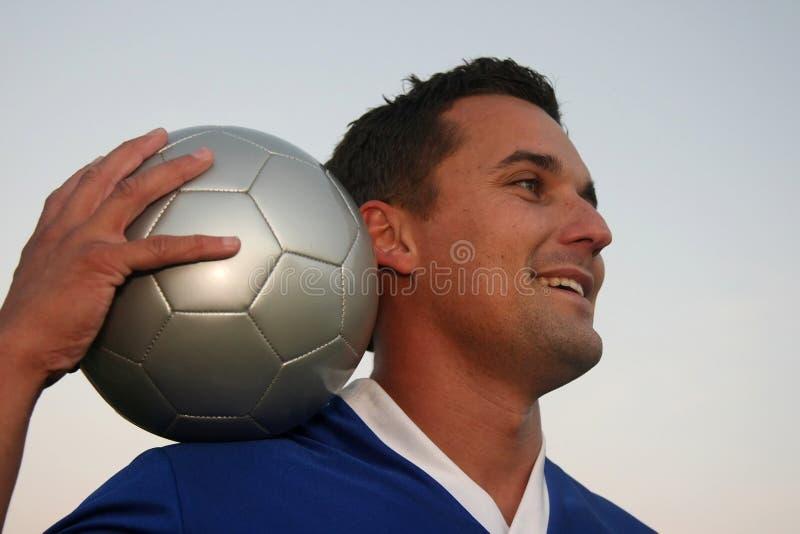 Jugador de fútbol y bola foto de archivo libre de regalías